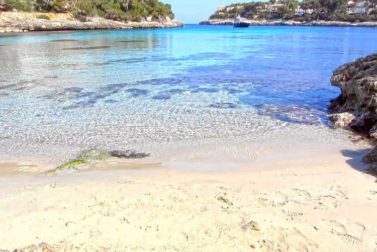 Sandy beach of Porto Petro small harbor town in the southeast of Mallorca