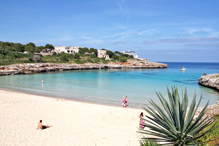 Sandy beach Cala Marcal in Porto Colom, Majorca